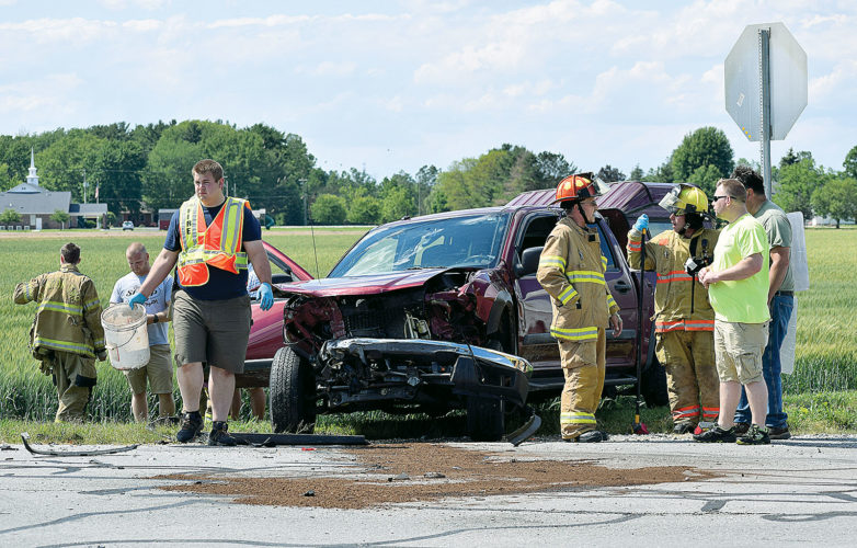 PHOTO BY JILL GOSCHE Rescue personnel work at the scene of an accident at SR 18 and CR 13 Monday afternoon.