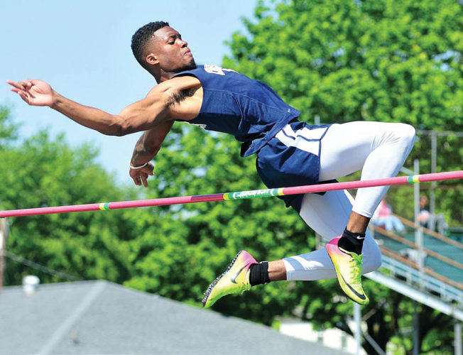PHOTOSBYPATGAIETTO Columbian's Ro Durham clears 6-0 in the high jump, an event he went on to win at the Northern Ohio League meet in Norwalk.