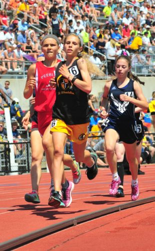 PHOTO BY PAT GAIETTO St. Wendelin's Sophia Volpe (front) leads runners around a turn in the 3,200 in the Division III state meet Saturday.