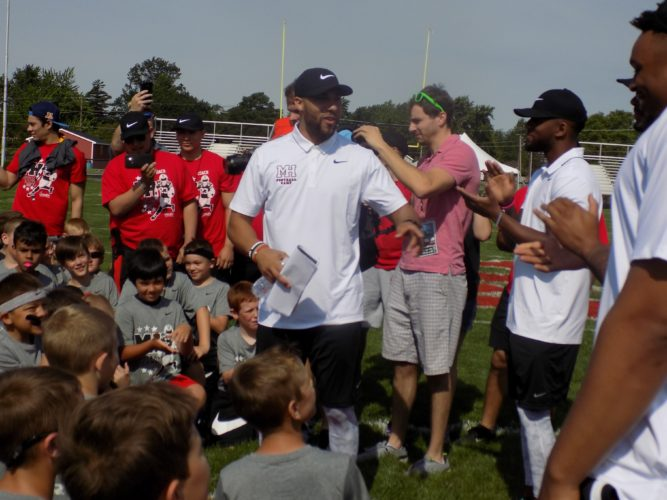 PHOTO BY ZACH BAKER Buffalo Bills' Micah Hyde, a Fostoria native, speaks to a group of kids at the Micah Hyde Football Camp in Fostoria Saturday.