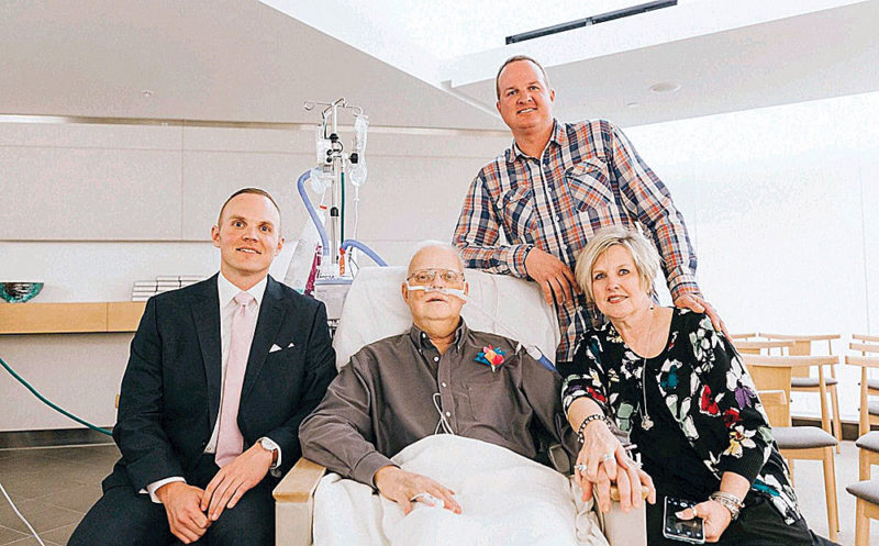 PHOTO COURTESY OF CARTWRIGHT FAMILY Kent Cartwright (second from left) is surrounded by his sons, Brent (far left) and Nick, and his wife, Lynne. He died early Monday morning, three days after he watched Brent's wedding from his hospital room.