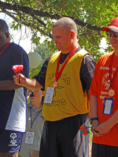 PHOTO BY NICOLE WALBY Matthew Spencer is seen after receiving a gold medal for his throw Friday during the Special Olympic State Summer Games in the softball throw competition.
