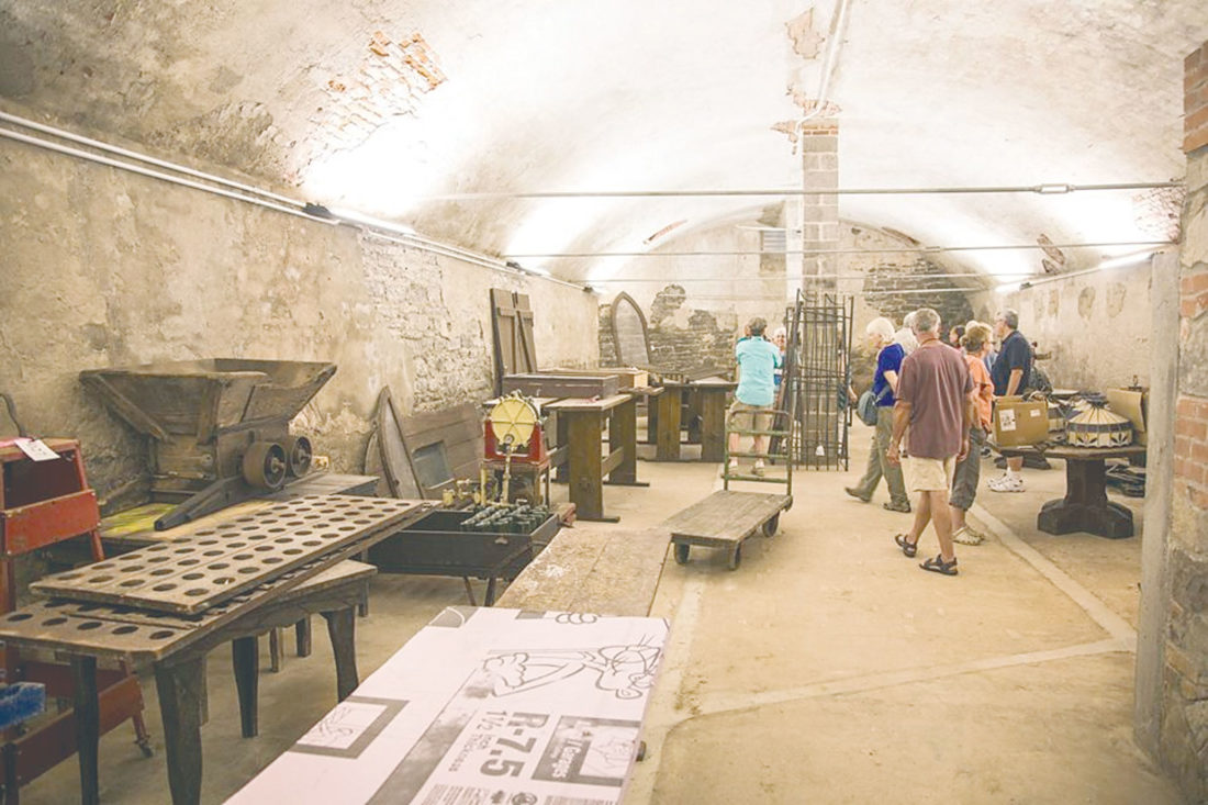 PHOTO SUBMITTED Visitors tour one of the cellars during the grand opening in June.