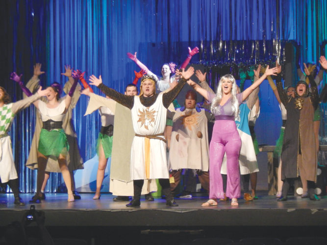 """PHOTO BY NICOLE WALBY Charles Groth as Arthur (left) and Darci Porter as the Lady of the Lake (right), along with their fellow cast members, perform during a dress rehearsal of The Ritz Players production of Monty Python's """"Spamalot"""" Tuesday."""
