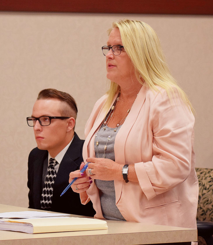 PHOTO BY JILL GOSCHE Levi M. Crotinger (left) sits next to his attorney, Cynthia Welty, during a hearing in Seneca County Common Pleas Court Judge Michael Kelbley's courtroom Friday morning.