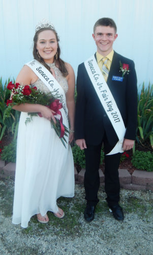 PHOTO BY NICOLE WALBY The 2017 Seneca County Junior Fair Queen Cate Frankart (left) and King Garrett McCoy pose for a photo after their crowning Monday evening.
