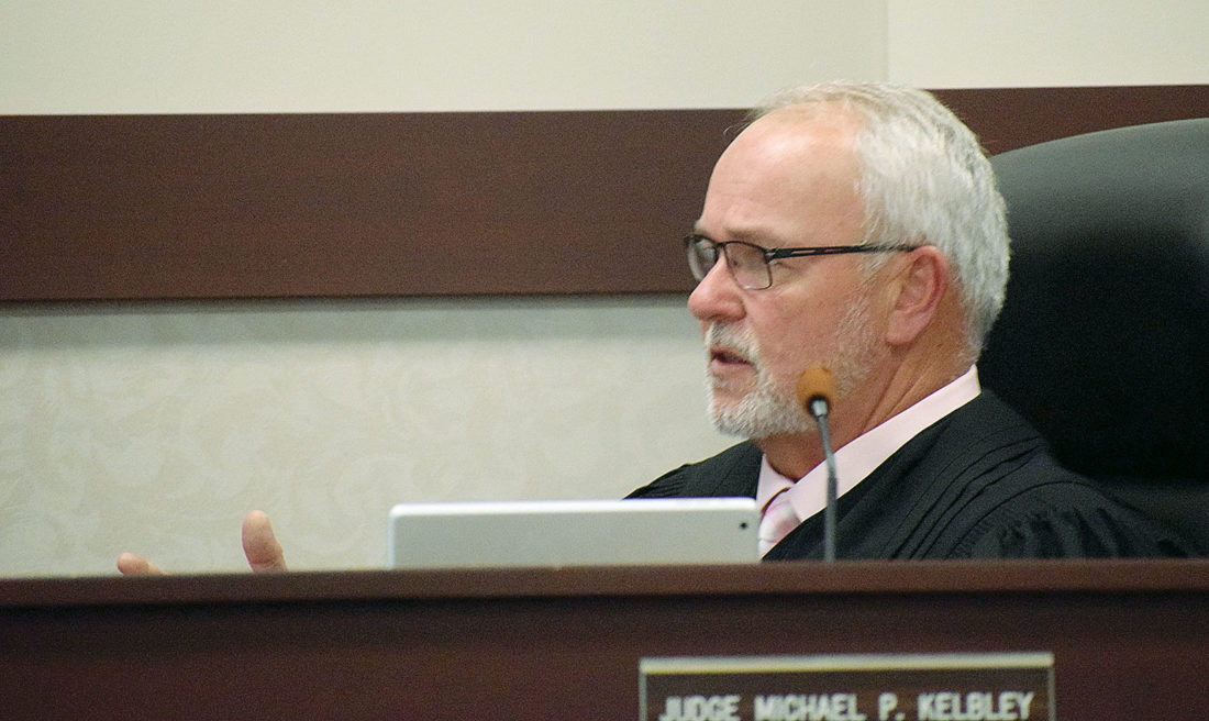PHOTO BY JILL GOSCHE Seneca County Common Pleas Court Judge Michael Kelbley speaks to a juror Wednesday morning.