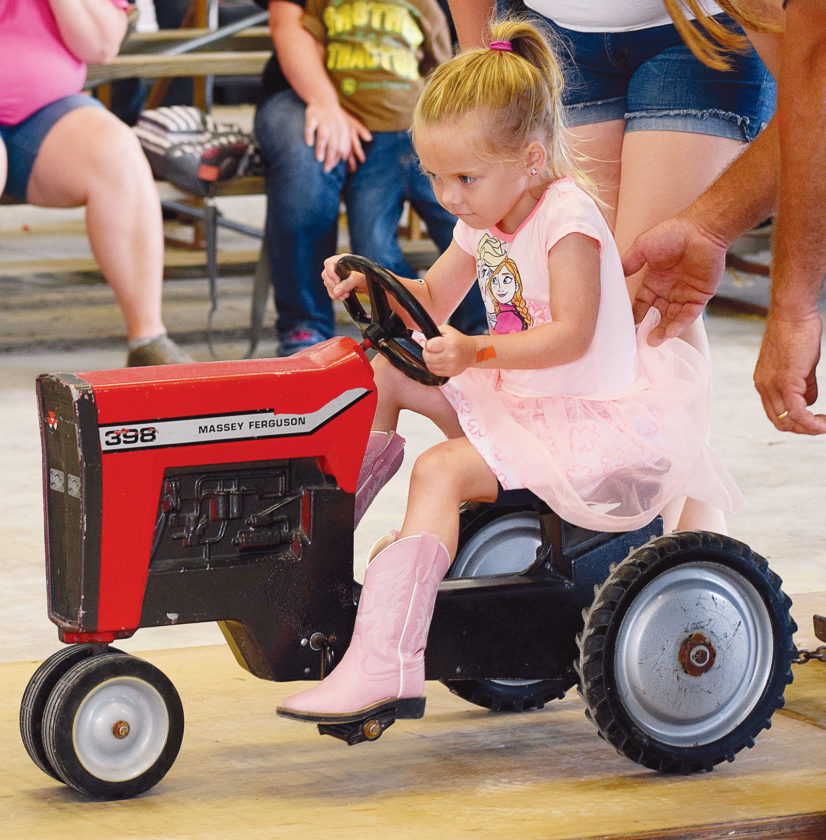 PHOTO BY JILL GOSCHE Tinleigh Mancuso, 4, participates in the kiddie tractor pull at Seneca County Fair Friday evening. To view more photos from this event, visit cu.advertiser-tribune.com.