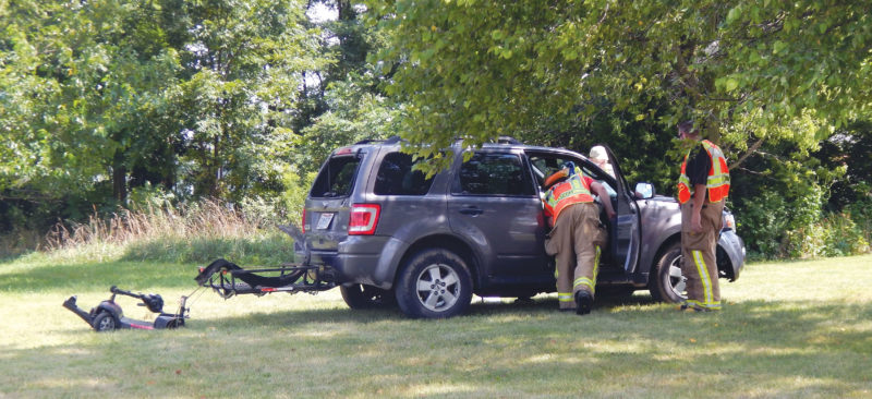 PHOTO BY JACOB GURNEY Rescue personnel and law enforcement assess the scene of a single-vehicle accident at CR 594 and CR 54 Saturday afternoon.