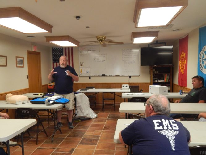 PHOTO BY JACOB GURNEY Director Ken Majors of Seneca County Emergency Medical Services explains how the autopulse device works at the Bloom Township Fire and EMS station Sunday evening.