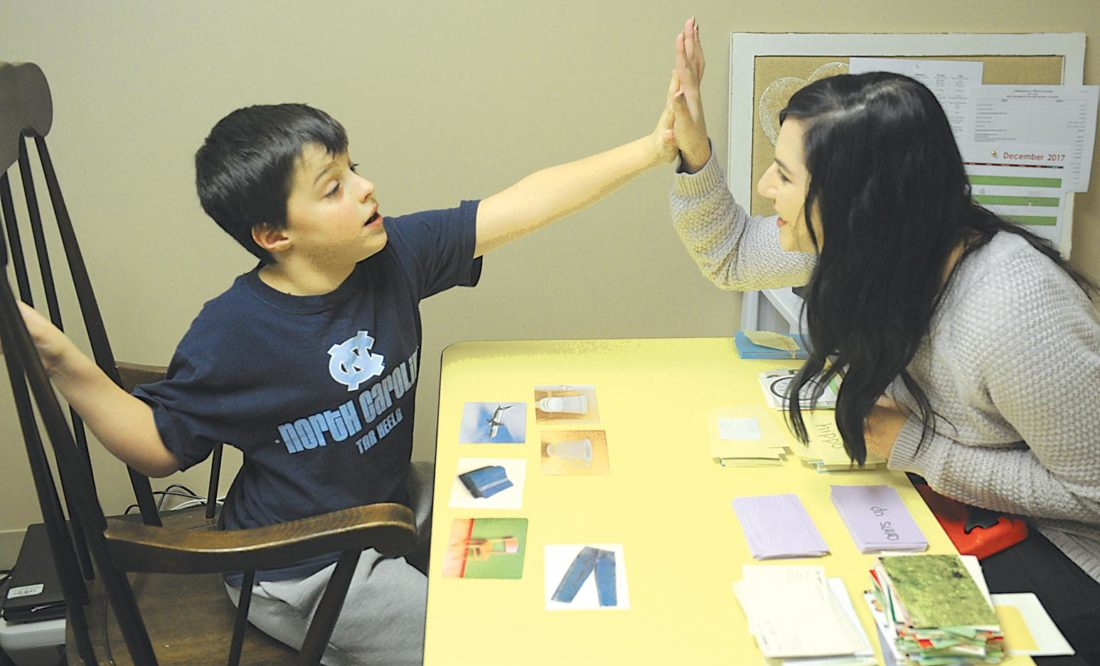 Technician Tabitha Clowson Works With Ryan Finochio 7 Of Hollidaysburg On Wednesday At The Journey Center Autism Therapy School In Duncansville