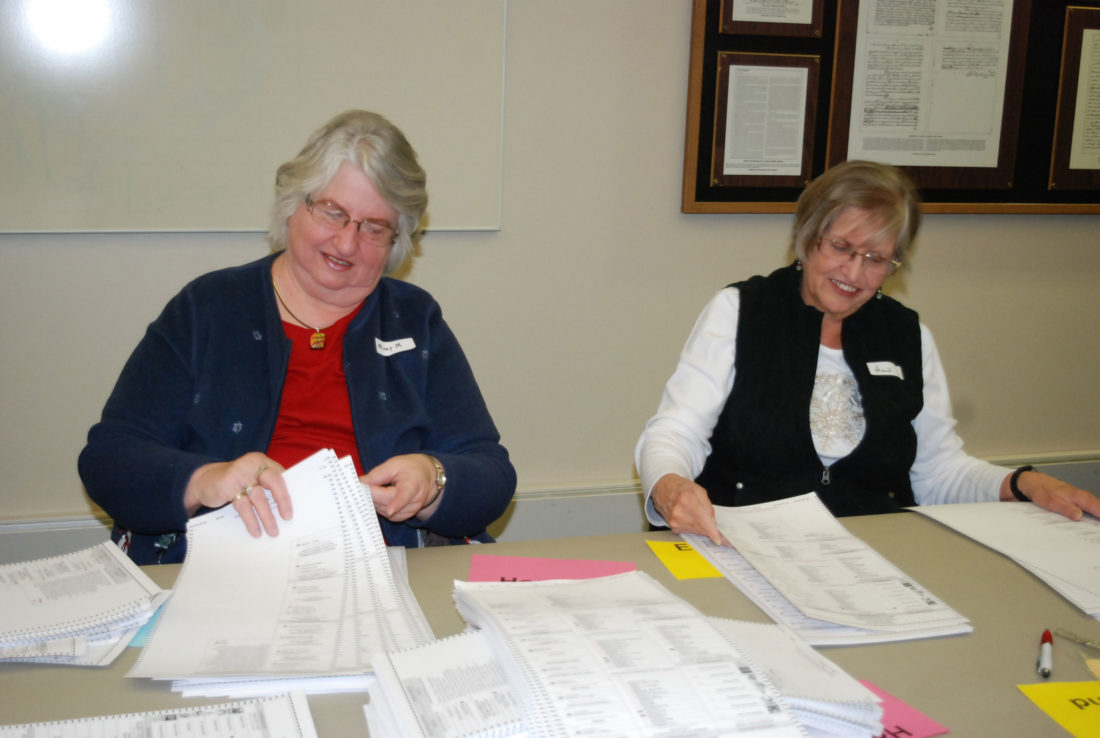 Jordan Beck | Daily Press Mary Madalinski, left, and Gail Johnson, review Delta County's general election ballots during a vote recount held at Escanaba City Hall Tuesday. The recount focused on votes cast in the county's narrow Bay College Board of Trustees race.