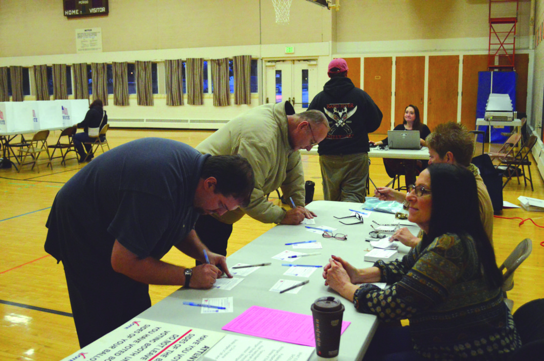Ilsa Matthes   Daily Press Residents sign up to receive their ballots this morning at the Escanaba Civic Center, which serves as the city's 3rd Precinct. By 7:30 a.m., a steady stream of voters were already making their way into the gymnasium to cast their vote.