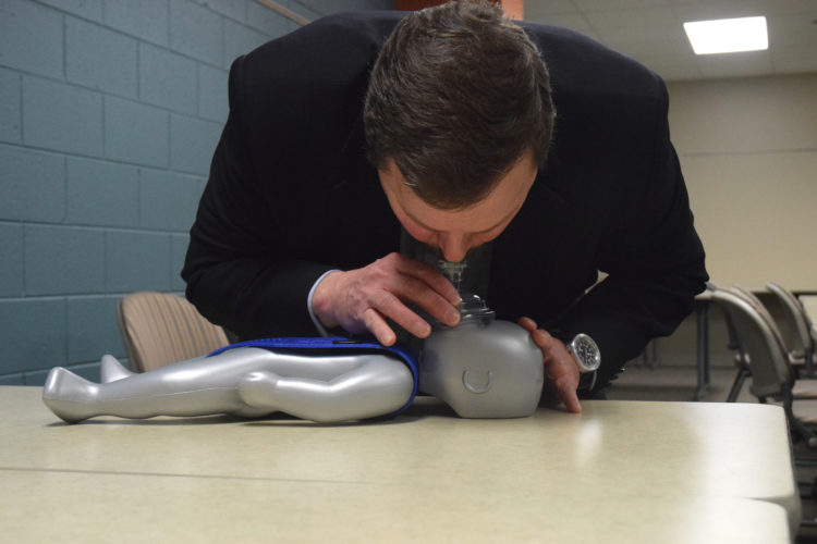Haley Gustafson | Daily Press Robert Pontius, executive director of professional and workforce development for Bay College's MTEC building, demonstrates mouth-to-mouth resuscitation on a baby mannequin Friday afternoon at M-TEC. A new law recently signed by Michigan Lt. Gov. Brain Calley mandates that students in grades seventh through 12th will have to learn CPR in a health course in order to graduate. The M-TEC center also provides CPR, AED, and First Aid courses through the American Heart Association every month starting in February.