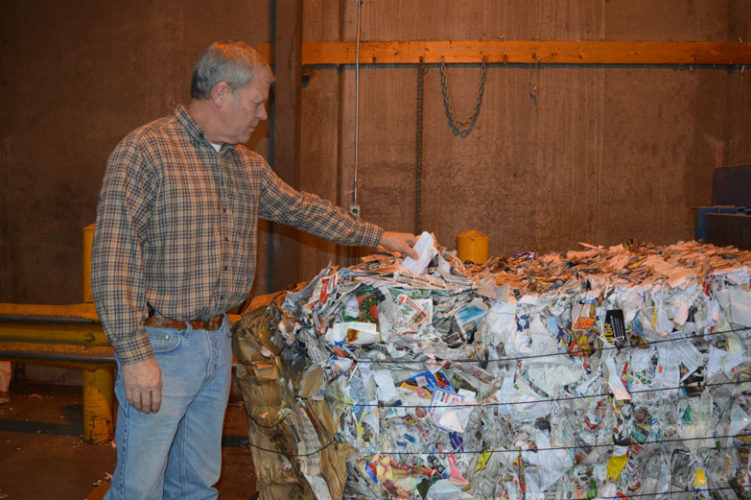 Jordan Beck | Daily Press Delta Solid Waste Management Authority Manager Don Pyle inspects a bale of recycled paper. Pyle said he hopes to eventually use funding from a new millage supporting the authority's recycling services to upgrade recycling equipment and create recycling education programs.