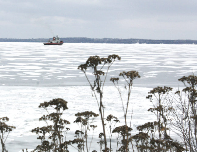 Jenny Lancour | Daily Press Basic Marine of Escanaba breaks up ice in Little Bay de Noc on Monday in anticipation of freighters coming into the bay. A winter storm warning is in effect until 7 p.m. today in the south central Upper Peninsula. Snow and patchy blowing snow is forecast for tonight.