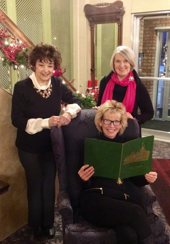 Courtesy photo AAUW (American Association of University Women) members Kathleen Bennett, left, and Susan Hampton review a menu with House of Ludington owner Suzell Eisenberger in preparation for AAUW's Jan. 19 New Year gathering.