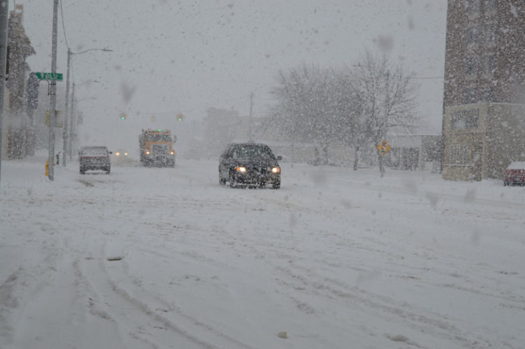 Haley Gustafson | Daily Press Snow falls as cars travel with caution down Ludington Street in Escanaba during a winter storm last week. According to local automotive experts, keeping vehicles maintained during the winter months is important to keeping them running — especially through snow and cold temperatures.
