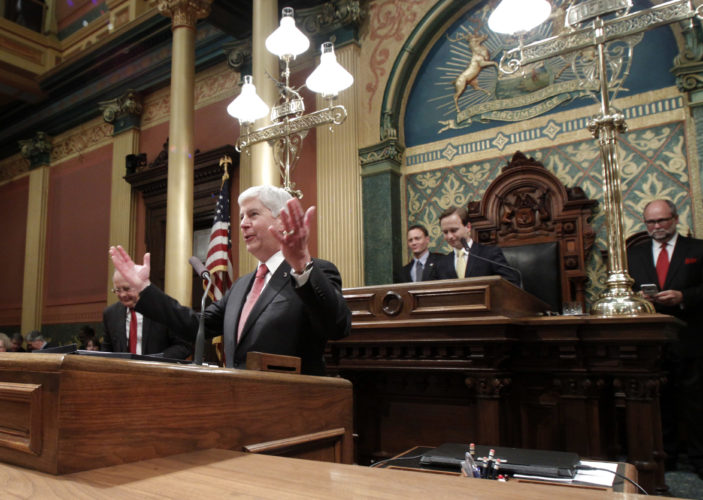 Michigan Gov. Rick Snyder greets guest before delivering his State of the State address to a joint session of the House and Senate, Tuesday, Jan. 17, 2017, at the state Capitol in Lansing, Mich. In the background are, from left, Clerk of the House Gary Randall, House Speaker Tom Leonard, Lt. Gov. Brian Calley and Senate Majority Leader Arlan Meekhoff. (AP Photo/Al Goldis)
