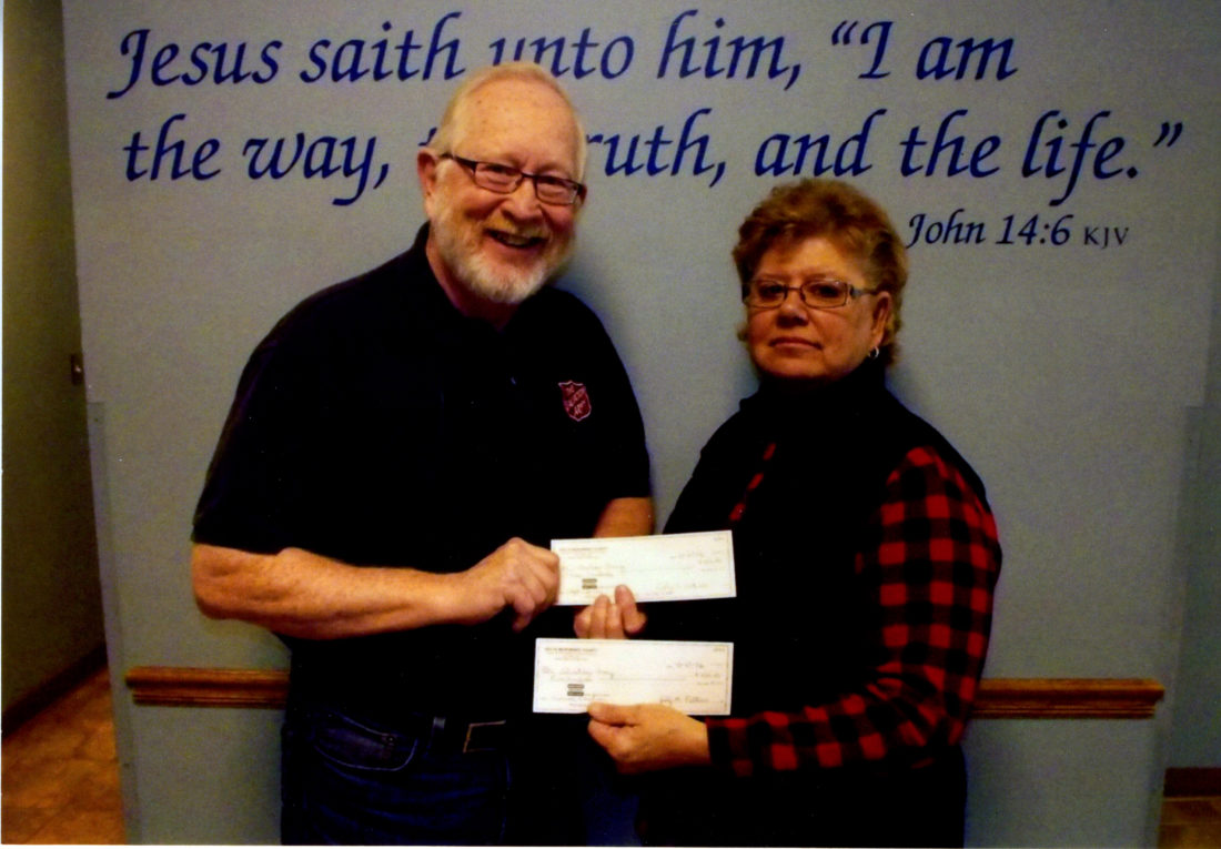 Courtesy photo The Delta Menominee Heart of the North Lions Club recently made its annual donation of $500 to the Salvation Army, and an additional $300 to Adpot a Family. Pictured,are, Major Ralph Hansen and Pat VanEnkevort, president of the Delta Menominee Heart of the North Lions Club.