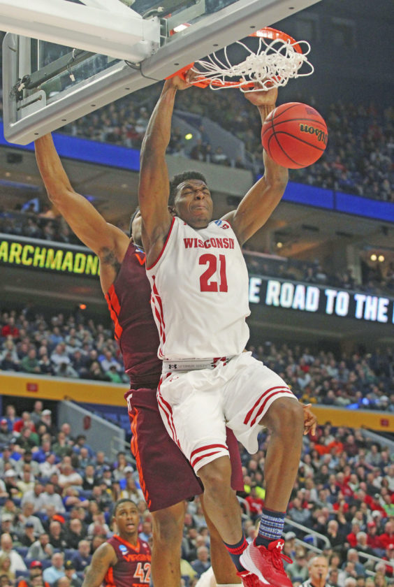 AP photo Wisconsin guard Khalil Iverson (21) scores on a dunk against Virginia Tech Thursday.
