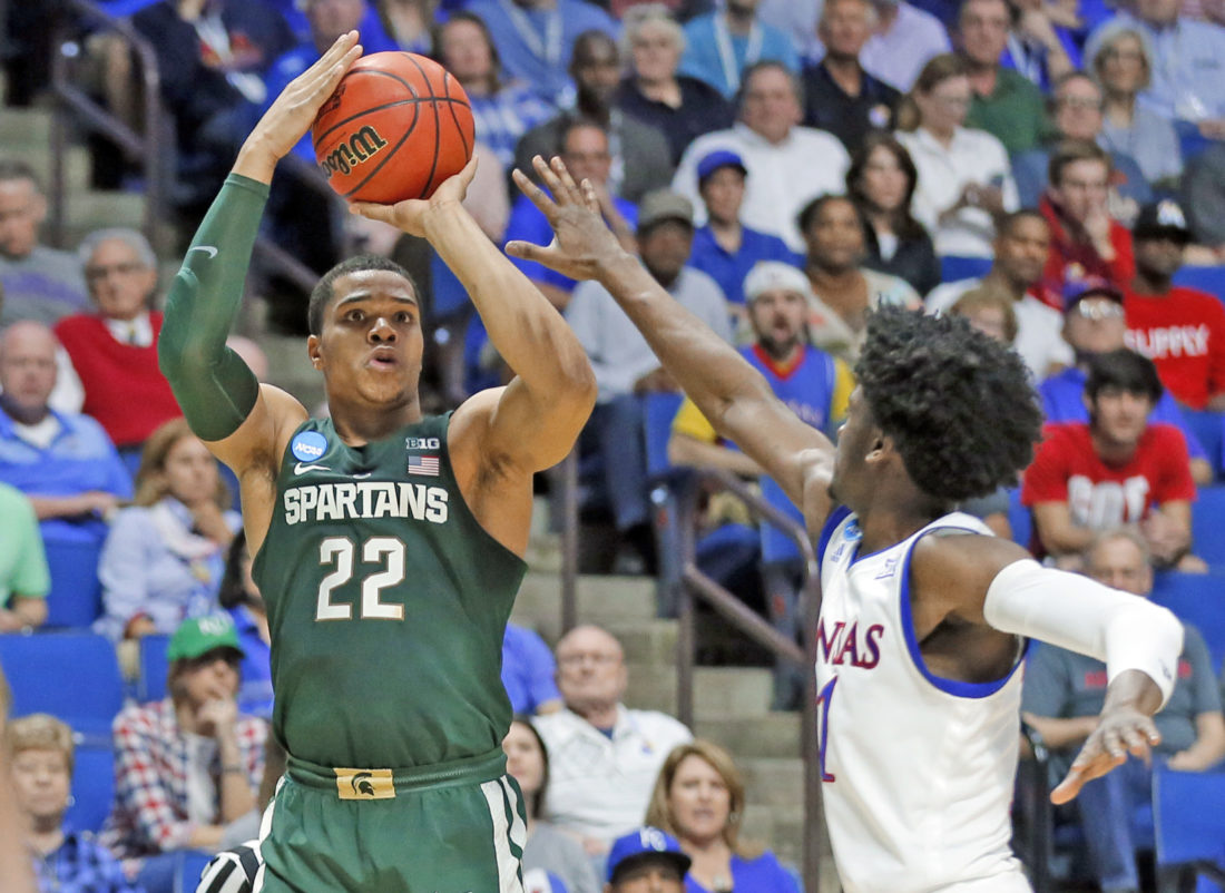 AP photo Michigan State guard Miles Bridges (22) attempts a 3-pointer over Kansas' Josh Jackson (11) Sunday. The friends from Michigan competed intensely all game — Bridges scored 22 points, but Jackson had 23 points in the Jayhawks' victory in Tulsa, Okla.