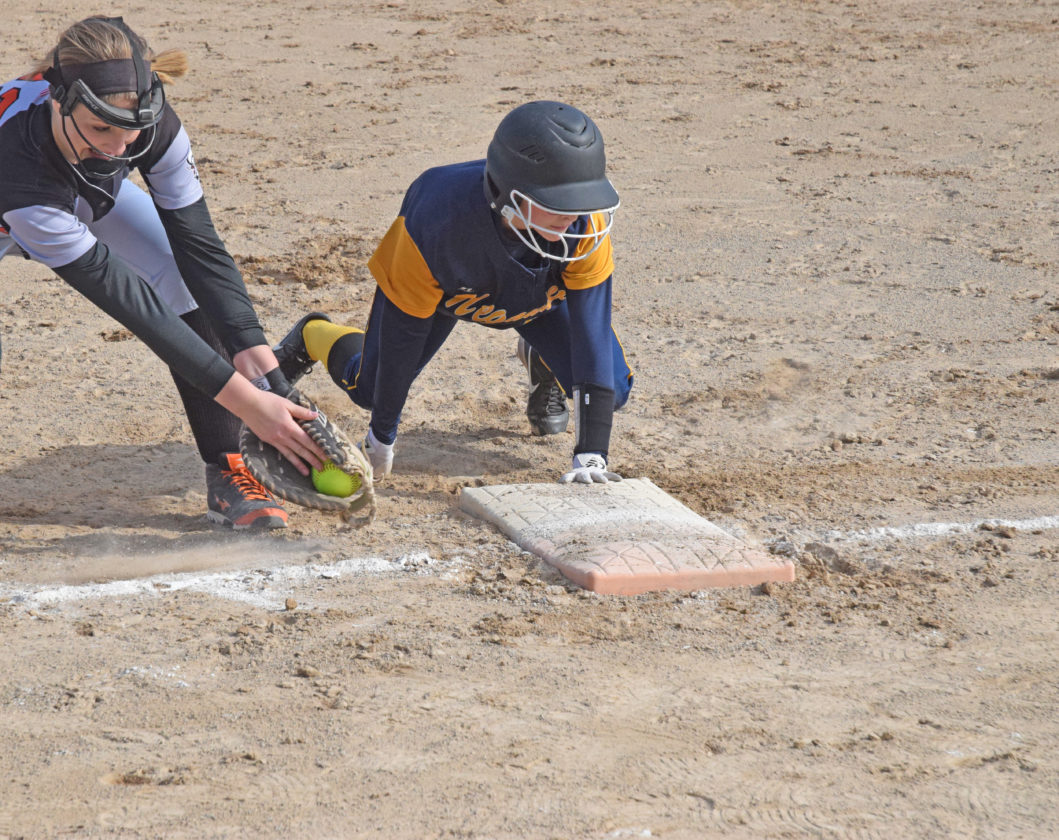 ­­Mike Mattson | Daily Press Escanaba first baseman Savanah Barron, left, attempts a late tag on Negaunee runner Delaney McLaughlin on a pickoff attempt in Wednesday's first game.