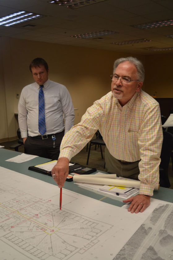 Jordan Beck | Daily Press Securitecture President Joseph Mrak, right, discusses plans for the new Delta County Correctional Facility as County Administrator Ryan Bergman looks on.