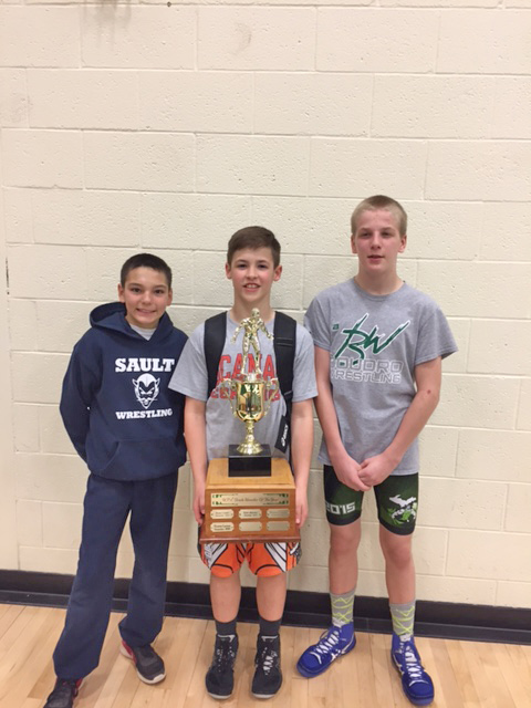 Courtesy photo Recipients of the Eighth Grade Wrestler of the Year Award are from left: Nathan Hermans of Sault Ste. Marie, Collin Arnt of Escanaba and Bradley Hall from Rudyard.