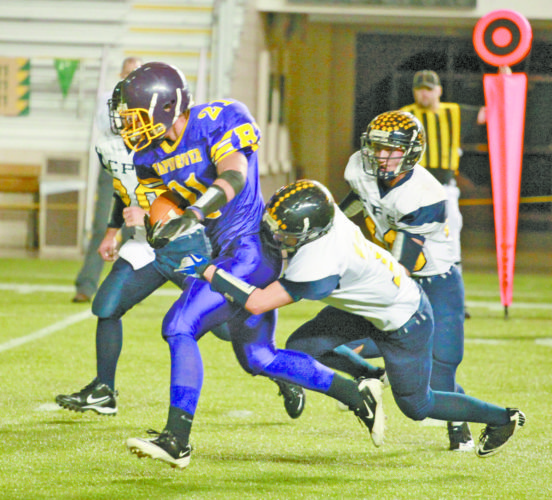 Mining Journal file photo A Rapid River runner is tackled by a Carsonville-Port Sanilac defender during the 8-player football championship game at the Superior Dome in Marquette in November 2011. The title game, which will morph into two championship contests this fall, will again be conducted at the dome in November.