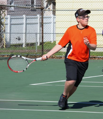 Courtesy photo Escanaba freshman Travis Burch gets ready to return a shot in Friday's No. 4 doubles match against Gladstone. The Eskymos won the meet 5-3.