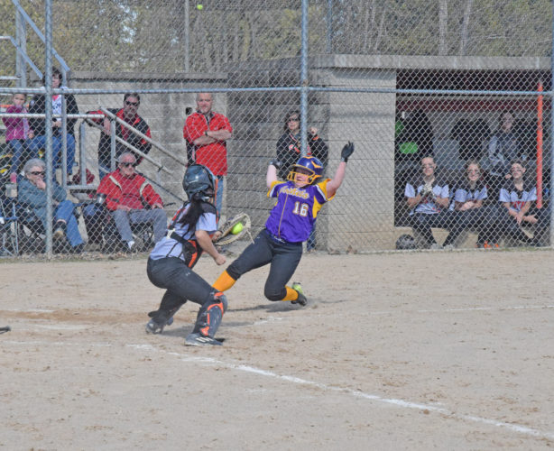 Mike Mattson | Daily Press Escanaba catcher Taylor Segorski gets set to apply a tag near the plate on Rapid River's Tina Olsen in the fourth inning Friday. Olsen was out on the play.