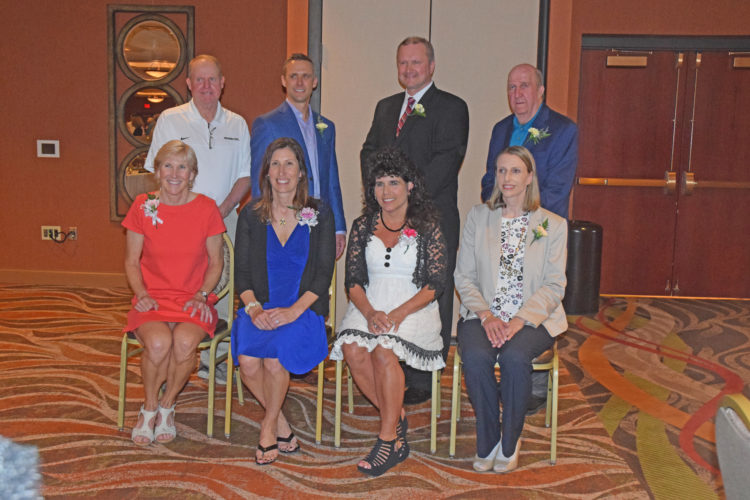 Mike Mattson | Daily Press Members of the 2017 Upper Peninsula Sports Hall of Fame class are front row from left: Hancock's Mary (Seaton) Brush, Kingsford's Lisa (Roell) Harry, Iron Mountain's Therese Altobelli and Kris Backstrom (representing her deceased her father Carl Backstrom of Calumet). Back row from left: Dave Inkala (representing his late brother Al Inkala of Wakefield), Gwinn's Greg Londo, Hancock's Chris Givens and Paul Lehto (representing Calumet's Jim Crawford). Lou Thesz of Banat was not represented and Brad Shouldice of Sault Ste. Marie did not attend due to illness.