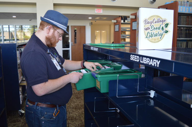 Jordan Beck | Daily Press  Bay College Library Director Oscar DeLong checks inventory for the Bay College Seed Library. Vegetable, fruit, and flower seeds are available to community members through this new program.
