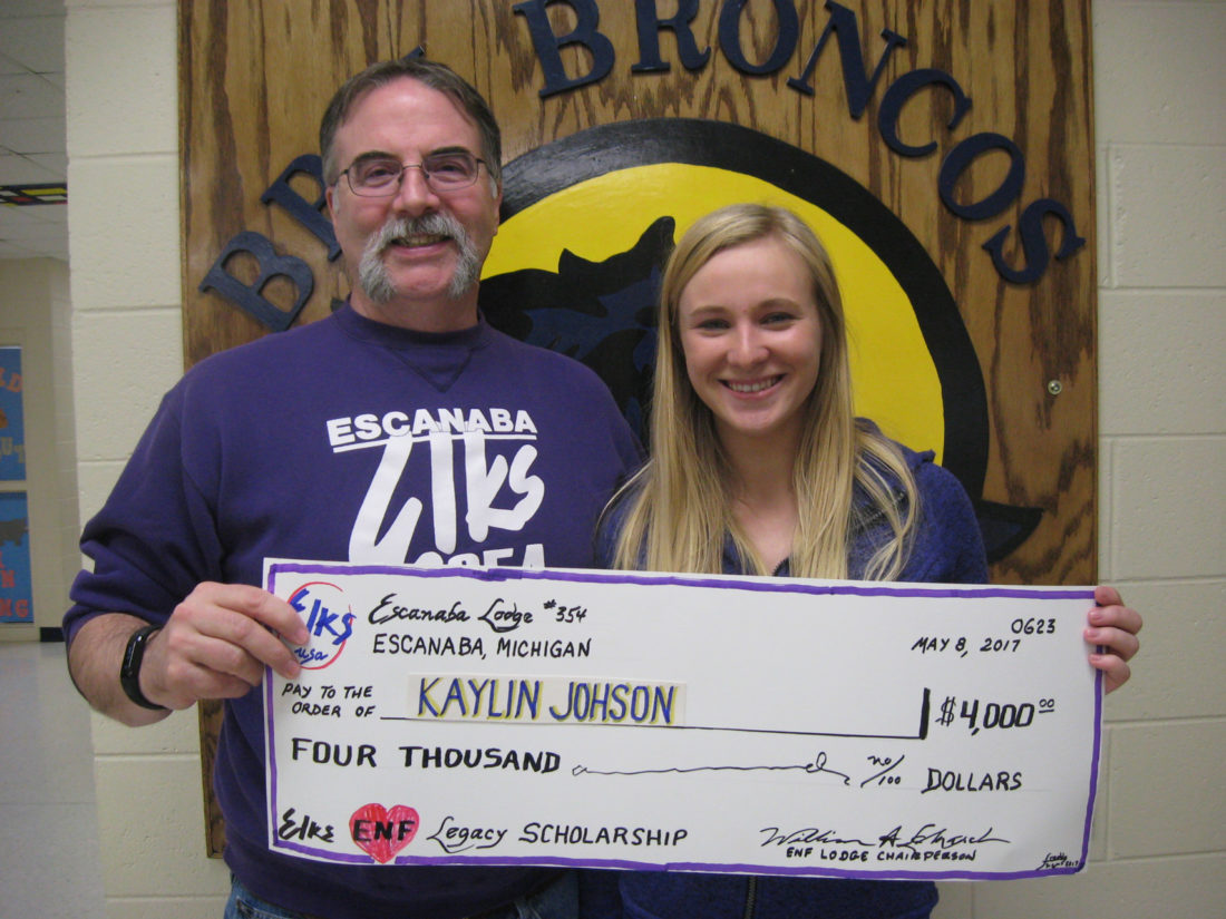 Courtesy photo Escanaba Elk John Pickard, presents Bark River High School senior, Kaylin Johnson, with a $4,000 Elks Legacy Scholarship. Kaylin plans to attend Ferris State University.