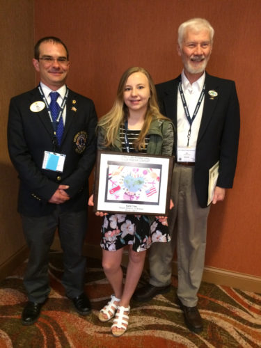 Courtesy photo Katie Viau, 7th grade student at Bark River-Harris, was the regional winner of the Single District 10 Lions Peace Poster contest. Entries are submitted across the Upper Peninsula, with one winner chosen to advance in the International Lions contest. Katie is pictured with Peace Poster Contest Chair, Joe Baczkowski and District Governor Matt Doney at the recent Lions convention, where she was recognized as the winner and awarded a plaque with a replica of her poster.