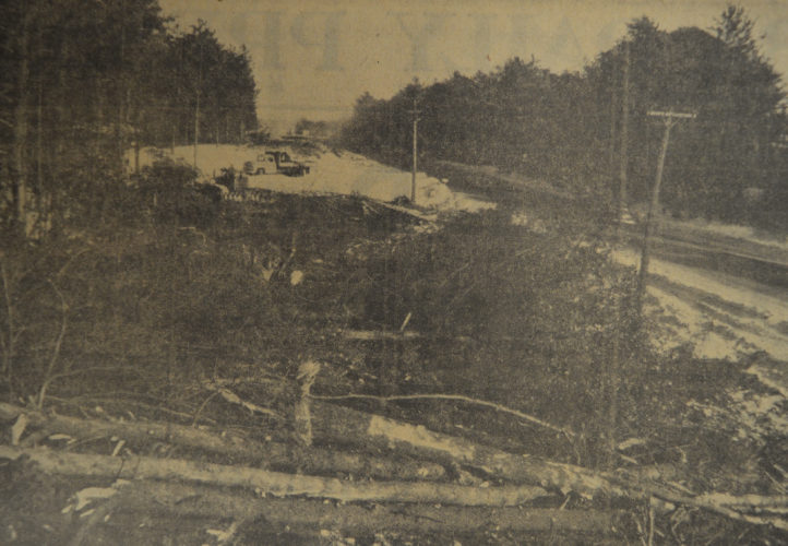 Daily Press photo Construction crews clear down trees to prepare Highway U.S. 2-41 for the creation of the four lane in 1957. Crews cleared trees north of Pioneer Trail Park for the development of the four-lane highway that runs between Escanaba and Gladstone. In order to remove trees and other brush, 24-ton tractors were brought it, brush was burned and the right-of-way was opened for grading before the paving process began the following spring. Tickler Construction Co, Black Creek Wis. were the subcontractors for the clearing and grading job.