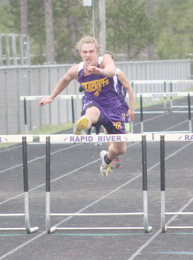 Avery Bundgaard | Daily Press Rapid River's Mason Berglund jumps the last hurdle on his way to a first place finish in the boys 300 meter hurdles Thursday during the Division 3 regional track meet in Rapid River.
