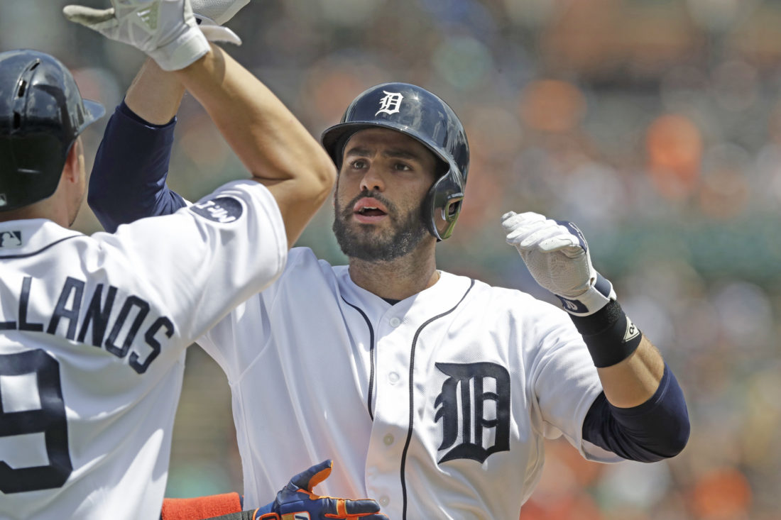 AP photo Detroit Tigers' J.D. Martinez is congratulated at home plate after his three-run home run in  the third inning Thursday against Baltimore.