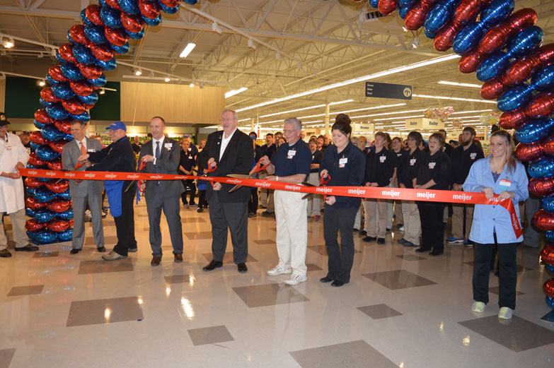 Haley Gustafson | Daily Press  Meijer leadership and team members, along with Escanaba's mayor take part in a ribbon cutting during the soft opening of the new Meijer store in Escanaba Thursday morning. The Escanaba location of the 24-hour superstore was one of two stores to open Thursday in the U.P. Shown, from left, cutting the ribbon are Meijer team member and meat cutter Dion Kuczewski, CEO and President of Meijer, Inc. Rick Keyes, Meijer team member Ed Schaefer, Escanaba Meijer Store Director Jeff Kietzman, Escanaba Mayor Marc Tall, and Meijer team members Harley Wunder, Lisa Waters and Jessica Hongisto.