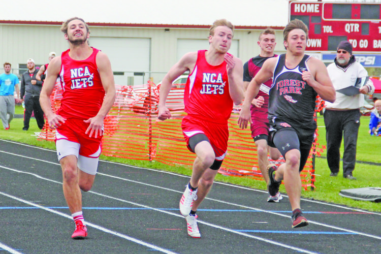 Adam Niemi | The Daily News Photo North Central's Dylan Gagne, center, edges teammate Bobby Kleiman, left, and Forest Park's Dylan Curtis, right, during the 100 meter dash Friday at the Division 3 regionals at North Dickinson.