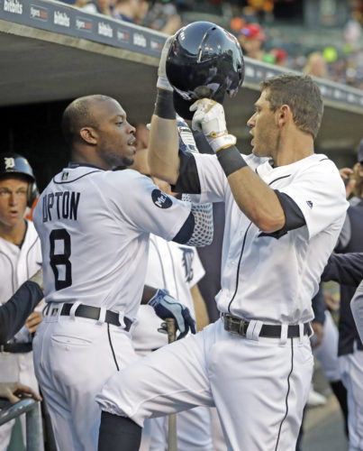 AP photo Detroit's Ian Kinsler, right, is congratulated by Justin Upton (8) after a solo home run in the first inning against Texas Sunday.