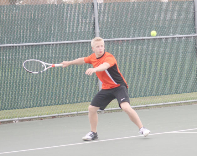 Avery Bundgaard | Daily Press Escanaba's Christer Carne gets ready to return a ball Monday against Iron Mountain's Tysen Wadge in a No. 1 singles match at Escanaba.