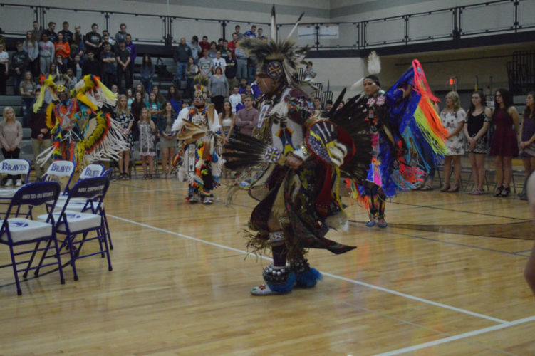 Haley Gustafson | Daily Press  Shane Mitchell, Woodland Sky Native American Dance Company co-founder and performer, dances Monday morning during the Native American Send Off Ceremony held for Gladstone High School seniors. The event, which featured speakers and performances, was held in honor of graduating seniors. In addition to the send off ceremony, the seniors also participated in Decision Day, which allowed the soon-to-be graduates to announce their future plans after high school.