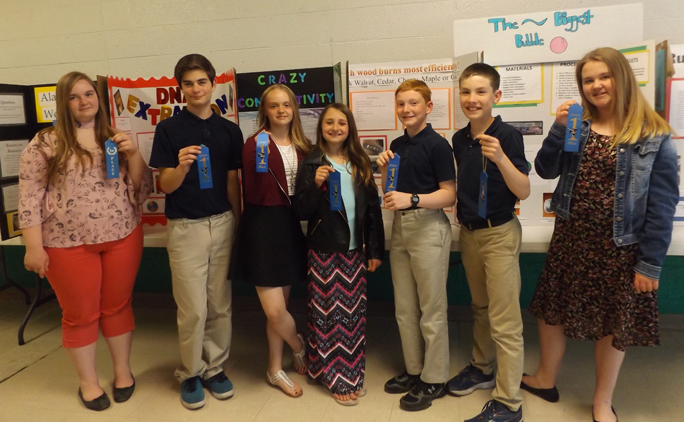 Courtesy photo The first place winners in Holy Name's annual Science and Academic Fair hold their blue ribbons and stand in front of their prize-winning boards.