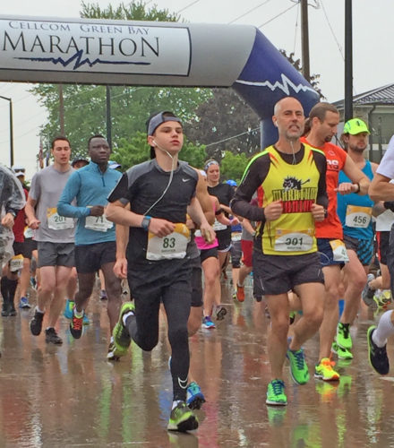 Courtesy photo Escanaba's Brodey Bevins, left, finished first in the 0-14 age group at the 2017 Cellcom Green Bay Marathon.  Bevins, 14, completed the 26.2 miles in 4:18.  He also finished first at the Green Bay Half Marathon in 2016.