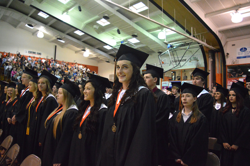 Jordan Beck | Daily Press Escanaba Area High School seniors pause for a moment after their procession before being seated at the beginning of the school's 2017 graduation ceremony. The ceremony was held in the school's gymnasium Friday evening.