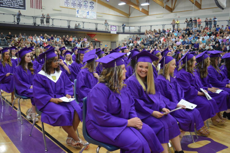 Jordan Beck | Daily Press Above, Gladstone Area High School ­senior girls revel in the moment as they wait for their diplomas during their ­graduation ­ceremony held Saturday afternoon in the school's gymnasium.