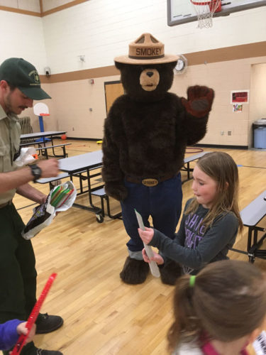 Courtesy photos Rapid River School sponsored a family fun night on May 24 for families to explore the various opportunities available this summer. Representatives from the YMCA, Bonifas, Gladstone Library, 4-H, and many more, were there to explain the programs they have available for area families. Activities for the kids included Smokey Bear, Echolight Goat Farm, police, fire trucks, Valley Med Flight, and more.