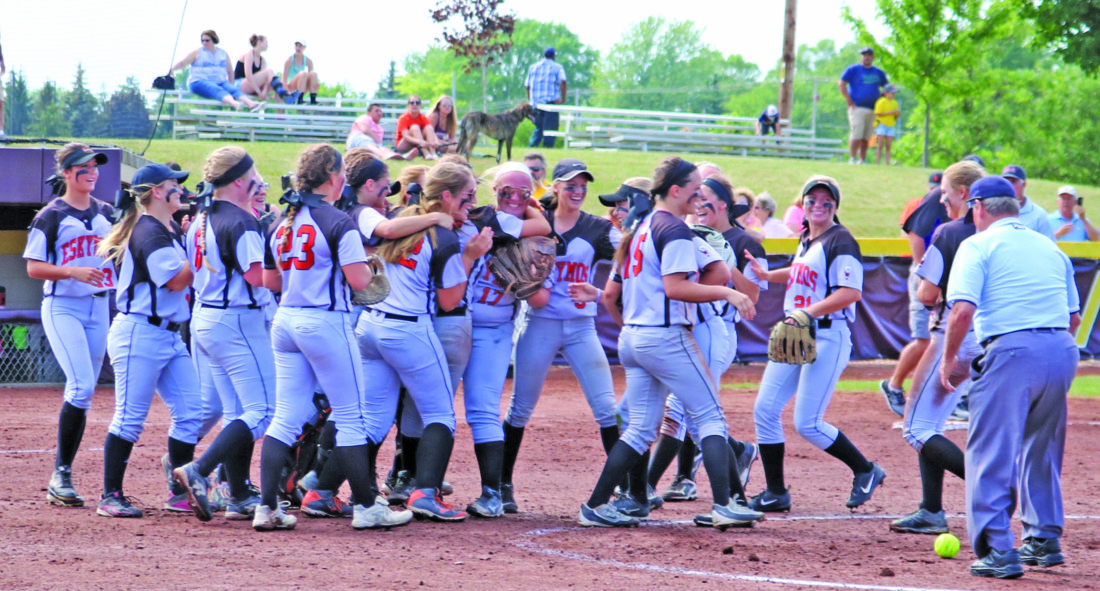 Photo by Tim Robinson The Escanaba softball team celebrates its Division 2 quarterfinal win Tuesday following its 5-0 victory over top-ranked Saginaw Swan Valley in Mount Pleasant.